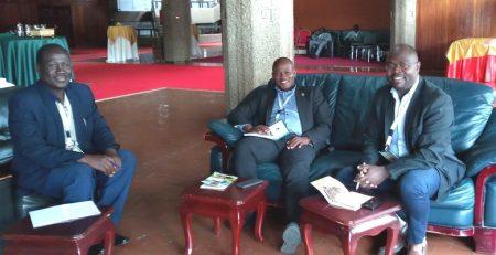 r. Casim Umba Tolo (L), Prof. Jude Lubega (M) and Dr. Drake Patrick Mirembe (R) at KICC Nairobi Discussing the Implementation of PHARMBIOTRAC ICT Starnd.