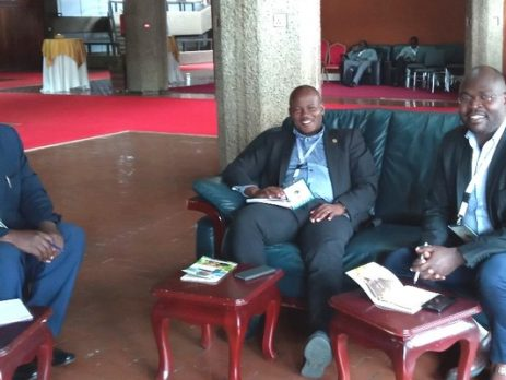 r. Casim Umba Tolo (L), Prof. Jude Lubega (M) and Dr. Drake Patrick Mirembe (R) at KICC Nairobi Discussing the Implementation of PHARMBIOTRAC ICT Starnd.